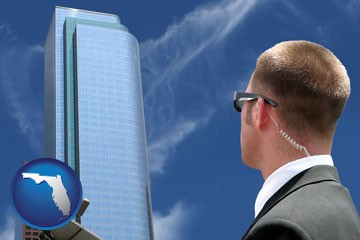 security agent watching a downtown area - with Florida icon