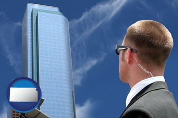 security agent watching a downtown area - with Kansas icon