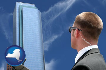 security agent watching a downtown area - with New York icon