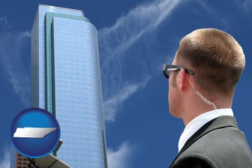 security agent watching a downtown area - with Tennessee icon