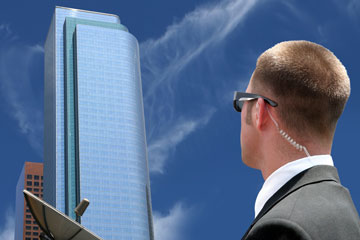 security agent watching a downtown area